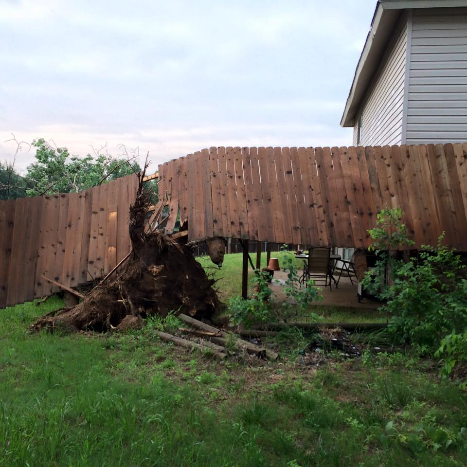 The damage that my neighbor's falling tree did to the fence line
